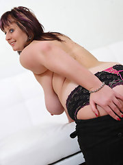 Brunette plump mature stripping and fingering pussy