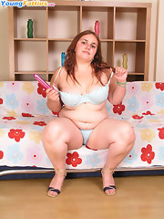 Curly redhead plump mature stripping on the armchair